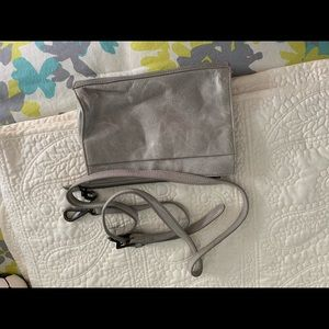 Hobo light gray leather crossbody bag.